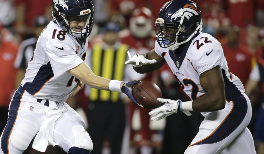 Denver Broncos quarterback Peyton Manning (18) hands off the ball to running back C.J. Anderson (22) during the first half of an NFL football game against the Kansas City Chiefs in Kansas City, Mo., Thursday, Sept. 17, 2015. (AP Photo/Charlie Riedel)