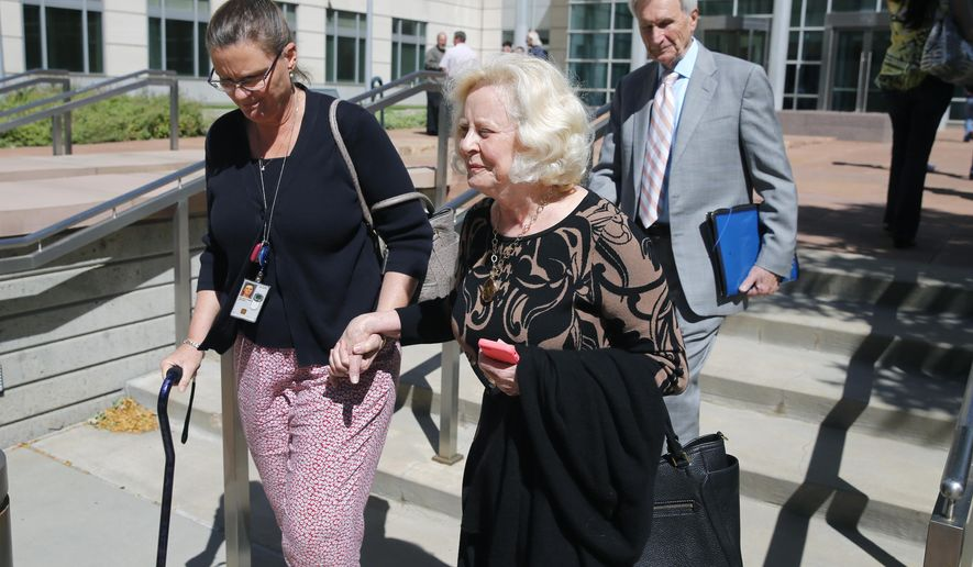 Yvonne and Bob Bertolet, center and right, the parents of Toni Henthorn, walk with a family friend from a federal courthouse in Denver, Friday, Sept. 18, 2015, following closing arguments in the murder trial of Harold Henthorn, who is charged with killing his second wife, Toni Henthorn, on a hike they took to celebrate their wedding anniversary in 2012. (AP Photo/Brennan Linsley)