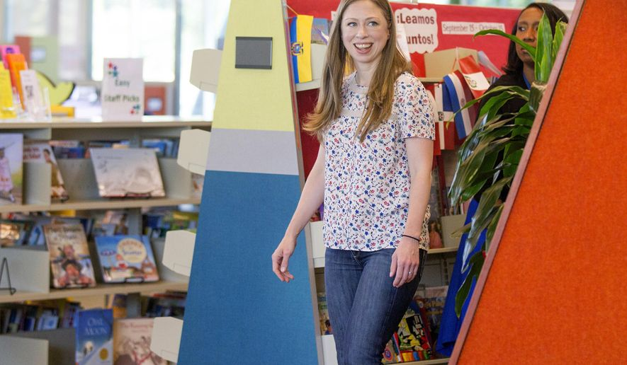 Chelsea Clinton rounds a corner during her tour of the The Hillary Rodham Clinton Children's Library & Learning Center Friday, Sept. 18, 2015, in Little Rock, Ark. (AP Photo/Gareth Patterson)