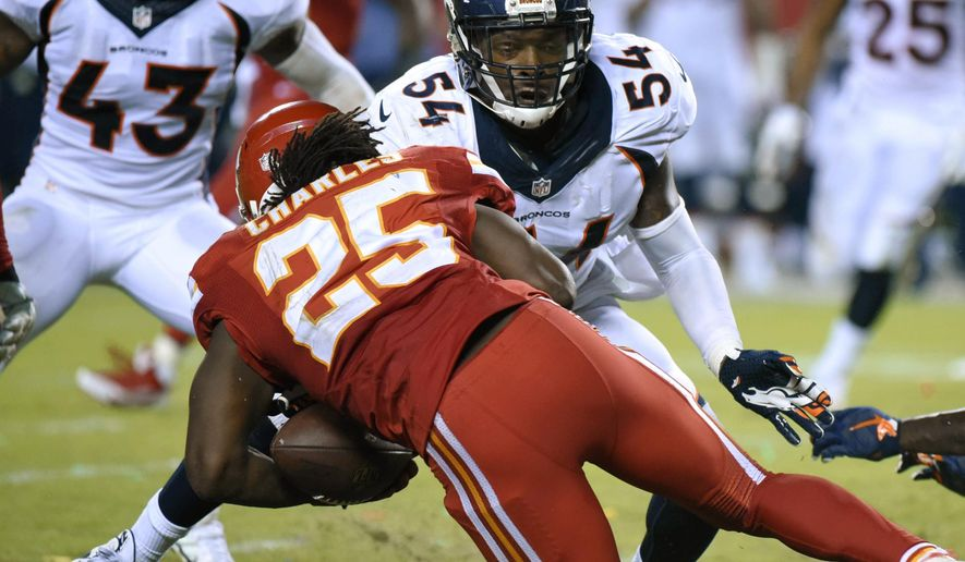 Kansas City Chiefs running back Jamaal Charles (25) is tackled by Denver Broncos linebacker Brandon Marshall (54) and fumbles the ball for a turnover during the second half of an NFL football game in Kansas City, Mo., Thursday, Sept. 17, 2015. The ball was recovered by Denver Broncos cornerback Bradley Roby and returned for a touchdown. Denver won 31-24. (AP Photo/Ed Zurga)