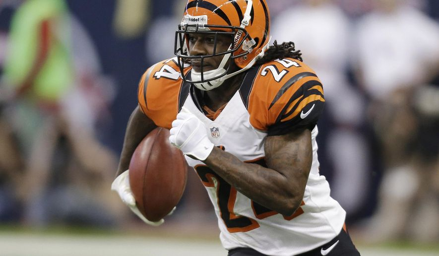 "In this Jan. 5, 2013, file photo, Cincinnati Bengals' Adam Jones runs the ball against the Houston Texans during an NFL wild card playoff football game in Houston. Bengals cornerback Adam ""Pacman"" Jones was fined $35,000 by the NFL for his personal foul against Raiders receiver Amari Cooper during their opener on Sunday, Sept. 13, 2015. (AP Photo/Eric Gay, File)"