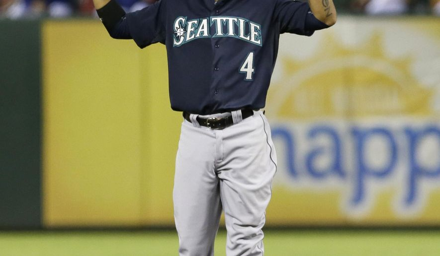 Seattle Mariners Ketel Marte stands on second base after hitting a two-run double during the second inning of a baseball game against the Texas Rangers in Arlington, Texas, Friday, Sept. 18, 2015. Brad Miller and Logan Morrison scored on the play. (AP Photo/LM Otero)