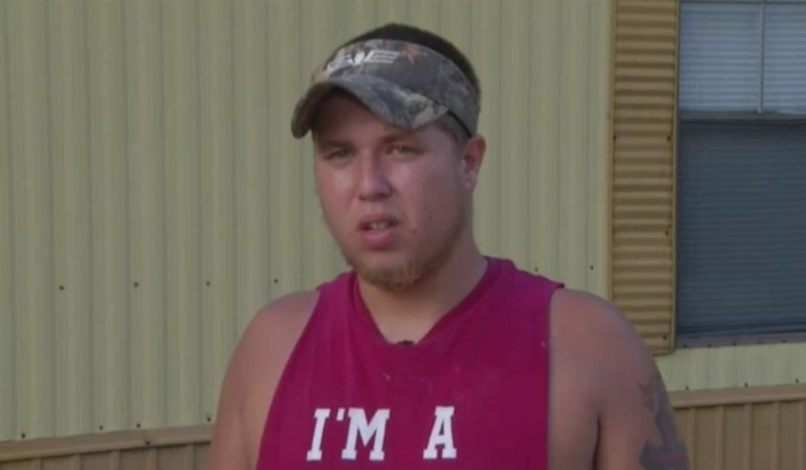 In this June 18, 2015, frame from video, Joseph Meek, friend of Dylann Roof who is accused of killing nine black church members during Bible study on June 17 in Charleston , S.C., speaks to The Associated Press. Meek was arrested Thursday, Sept. 17, more than a month after authorities told him he was under federal investigation for lying to them and failing to report a crime, an official close to the probe said. (APTN via AP)