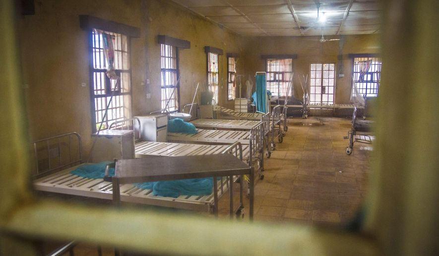 ADVANCE FOR USE SUNDAY, SEPT. 20, 2015 AT 9 P.M. EDT (0100 GMT) AND THEREAFTER - FILE - In this Sunday, Aug. 10, 2014 file photo, a ward at the government hospital in Kenema, eastern Sierra Leone lies empty after patients left and others were scared to be admitted, fearing they would contract the Ebola virus. More than 40 health workers at the facility have died from the virus. An Associated Press investigation has found a toxic mix of avoidable problems faced by Ebola responders, including weak leadership, shoddy supplies and infighting, exacerbated a chaotic situation at a critical front in the battle against the virus. (AP Photo/Michael Duff, File)