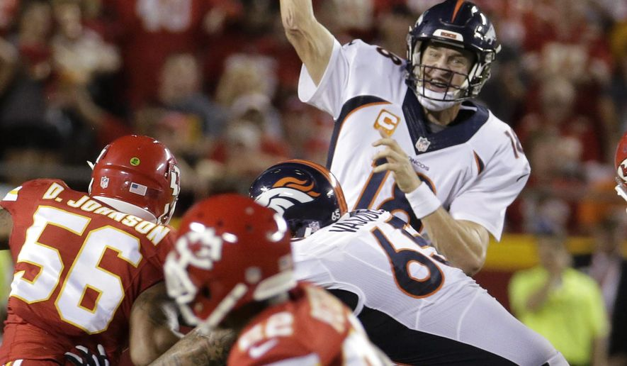 Denver Broncos quarterback Peyton Manning (18) throws a pass that Kansas City Chiefs' Marcus Peterss, foreground, intercepted during the first half of an NFL football game in Kansas City, Mo., Thursday, Sept. 17, 2015. (AP Photo/Charlie Riedel)
