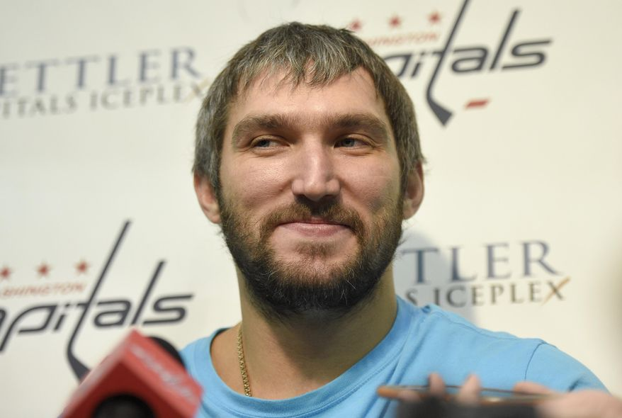Washington Capitals left wing Alex Ovechkin, of Russia, talks with the press during media day at NHL hockey training camp, Friday, Sept. 18, 2015, in Arlington, Va. (AP Photo/Nick Wass)