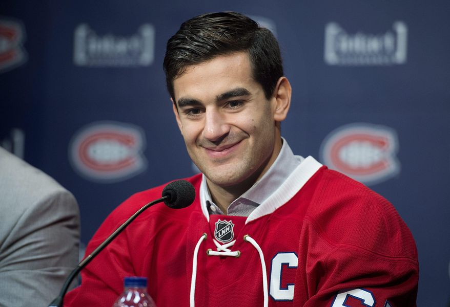 Montreal Canadiens' Max Pacioretty smiles during a news conference naming him as the new captain of the team at NHL hockey training camp in Brossard, Quebec, Friday, Sept. 18, 2015. (Graham Hughes/The Canadian Press via AP) MANDATORY CREDIT