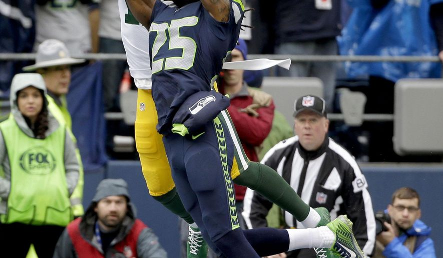 FILE - In this Jan. 18, 2015, file photo, Seattle Seahawks cornerback Richard Sherman (25) intercepts a pass intended for Green Bay Packers wide receiver Davante Adams (17) during the first half of the NFL football NFC Championship game in Seattle. The Packers probably don't need any extra incentive when facing the Seahawks this Sunday, particularly with the memory of their fourth-quarter NFC championship collapse in Seattle still fresh and painful.  (AP Photo/David J. Phillip, File)