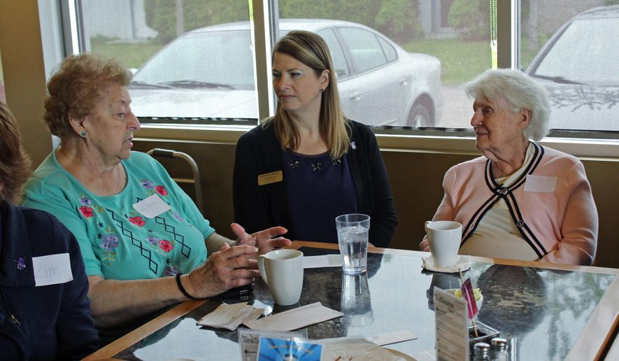"In this photo taken May 20, 2015, at Connections Cafe in Watertown, Wis., Shirley Strysick, right, 90, who suffers from dementia, talks with Stephanie Masche, center, from Heritage Homes assisted living facility, and an unidentified woman during a social and support group for those with the disease and their caregivers. The group called ""Memory Cafe"" is part of the city's efforts to become dementia friendly. (AP Photo/Carrie Antlfinger)"