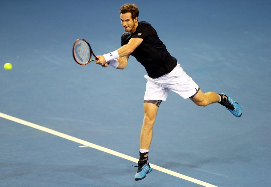 Britain's Andy Murray plays a return to Australia's Thanasi Kokkinakis during their Davis Cup semifinal tennis singles match in Glasgow, Scotland Friday Sept. 18, 2015. (AP Photo/Scott Heppell)