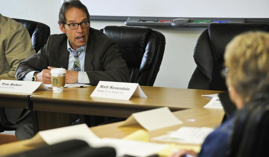 Chairperson Tim Baker addresses fellow members of the Montana Sage Grouse Oversight Team during an organizational meeting at the DNRC Central Land office in Helena, Mont., Friday afternoon, Sept. 18, 2015.  (Thom Bridge/The Independent Record via AP) MANDATORY CREDIT