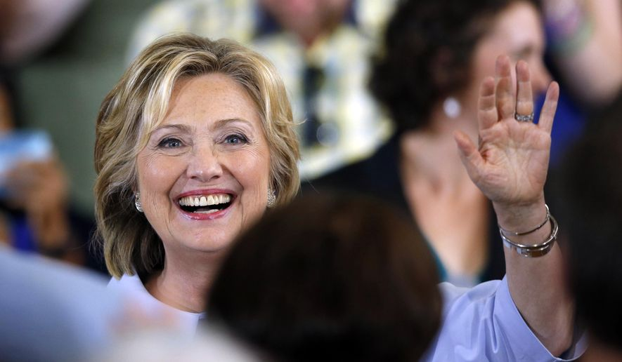Democratic presidential candidate Hillary Rodham Clinton acknowledges applause at a campaign organizing meeting, Friday, Sept. 18, 2015, in Portland, Maine. (AP Photo/Robert F. Bukaty)