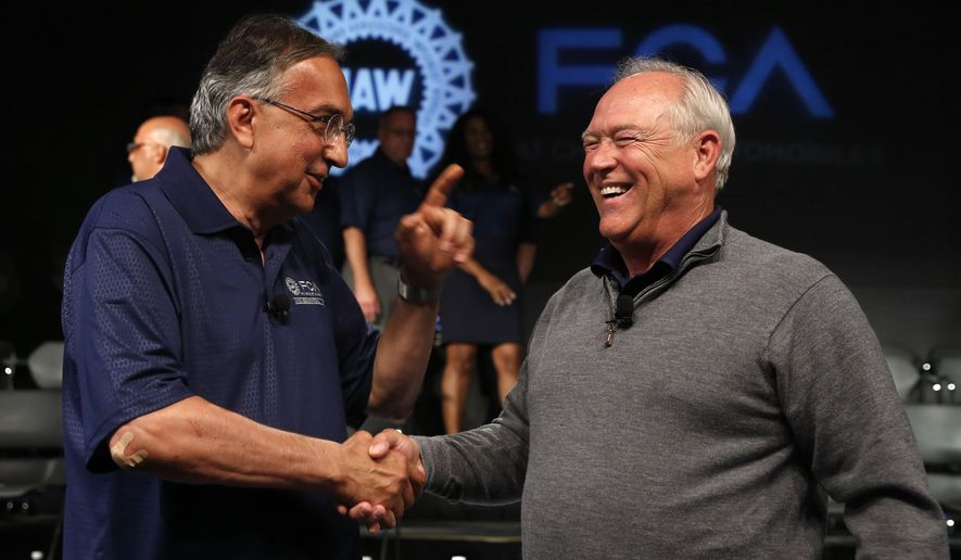 FILE - In this July 14, 2015 file photo, Fiat Chrysler Automobiles CEO Sergio Marchionne, left, and United Auto Workers (UAW) President Dennis Williams shake hands during a ceremony to mark the opening of contract negotiations in Detroit. Hourly pay, profit sharing and performance bonuses will rise, but car production will move to lower-cost Mexico and be replaced by trucks and SUVs under a new contract between Fiat Chrysler and the UAW, a person briefed on the deal said Friday, Sept. 18, 2015. (AP Photo/Paul Sancya, File)