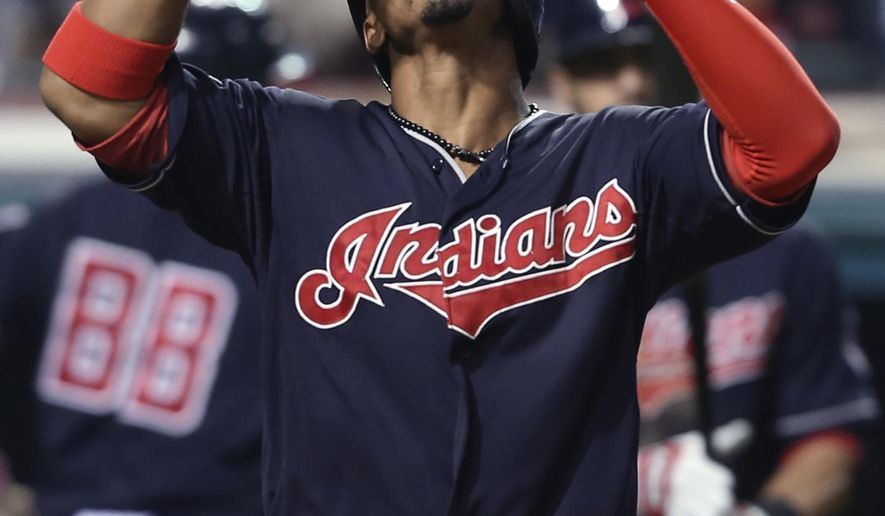 Cleveland Indians' Francisco Lindor celebrates after hitting a solo home run off Chicago White Sox starting pitcher Chris Sale during the seventh inning of a baseball game, Friday, Sept. 18, 2015, in Cleveland. (AP Photo/Ron Schwane)