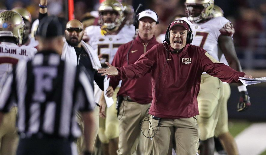 Florida State head coach Jimbo Fisher argues a call with an official during the first half of an NCAA college football game against Boston College in Boston, Friday, Sept. 18, 2015. (AP Photo/Charles Krupa)