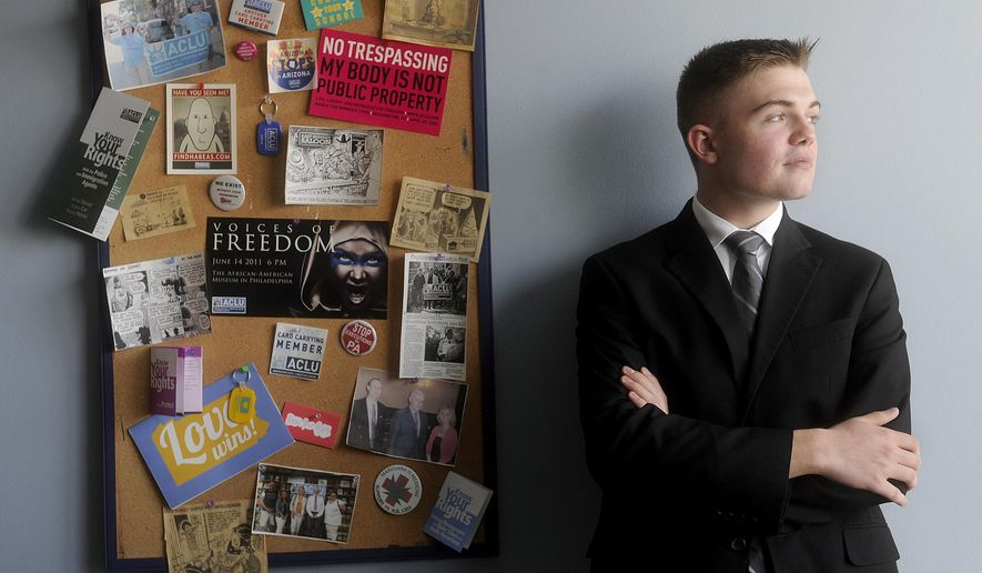 "ADVANCE FOR SATURDAY, SEPT. 19, 2015 - In this photo taken July 29, 2015, the son of a plaintiff in a 2004 lawsuit challenging instruction about ""intelligent design"" in biology classes in Pennsylvania's Dover Area School District, Griffin Sneath, stands in the Harrisburg, Pa., office of the American Civil Liberties Union of Pennsylvania on the last day of his internship there. Law, religion and culture intersected in the federal trial that began in September 2005, 10 years ago this month, and the case resonated across the U.S. and the world. Then in third grade, Sneath is now a 17-year-old senior at Central York High School in York, Pa., who is considering careers as a neurosurgeon or civil rights attorney. (Jason Plotkin/York Daily Record/Sunday News via AP) YORK DISPATCH OUT"
