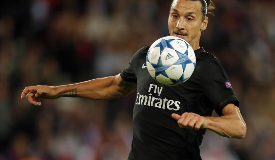 PSG's Zlatan Ibrahimovic controls the ball during the Champions League Group A soccer match between PSG and Malmo at the Parc des Princes stadium in Paris, France, Tuesday, Sept. 15, 2015. (AP Photo/Francois Mori)
