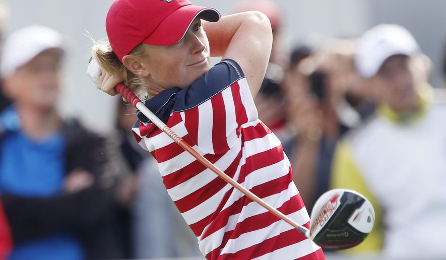 US Stacy Lewis hits a ball in the foursomes on Day1 of the Golf Solheim Cup in St.Leon-Rot, Germany, Friday, Sept. 18, 2015.(AP Photo/Michael Probst)