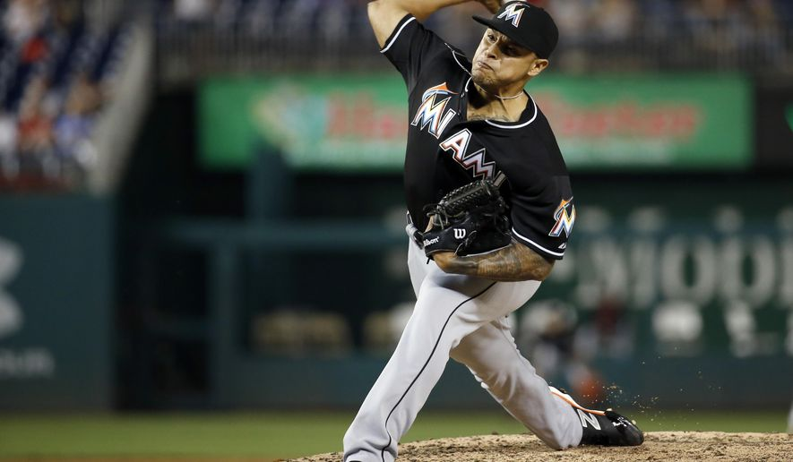 Miami Marlins relief pitcher A.J. Ramos throws during the ninth inning of a baseball game against the Washington Nationals at Nationals Park, Thursday, Sept. 17, 2015, in Washington. The Marlins won 6-4. (AP Photo/Alex Brandon)