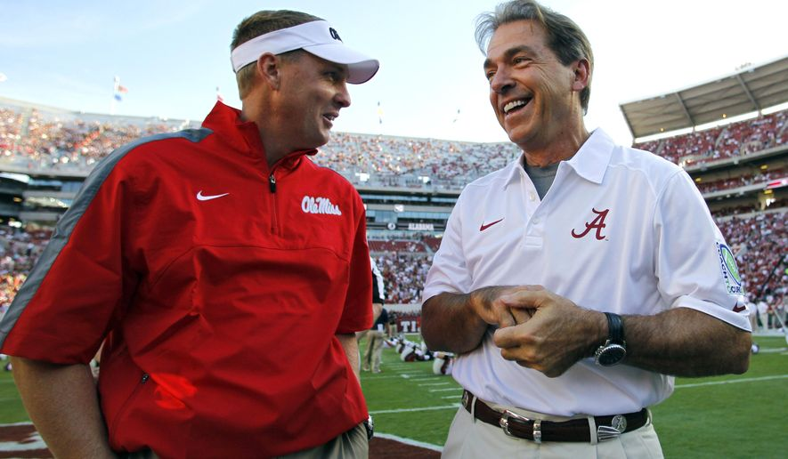 FILE - In this Sept. 28, 2013, file photo, Alabama head coach Nick Saban talks with Mississippi head coach Hugh Freeze before an NCAA college football game in Tuscaloosa, Ala. The 15th-ranked Rebels and No. 2 Alabama take center stage in Tuscaloosa on Saturday night for a game with no shortage of story lines. (AP Photo/Butch Dill, File)