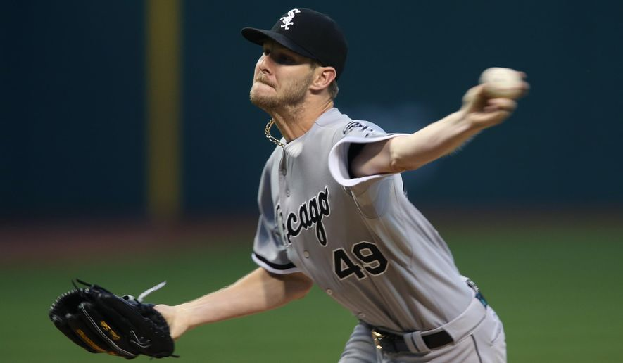 Chicago White Sox starting pitcher Chris Sale delivers to a Cleveland Indians batter during the first inning of a baseball game, Friday, Sept. 18, 2015, in Cleveland. (AP Photo/Ron Schwane)