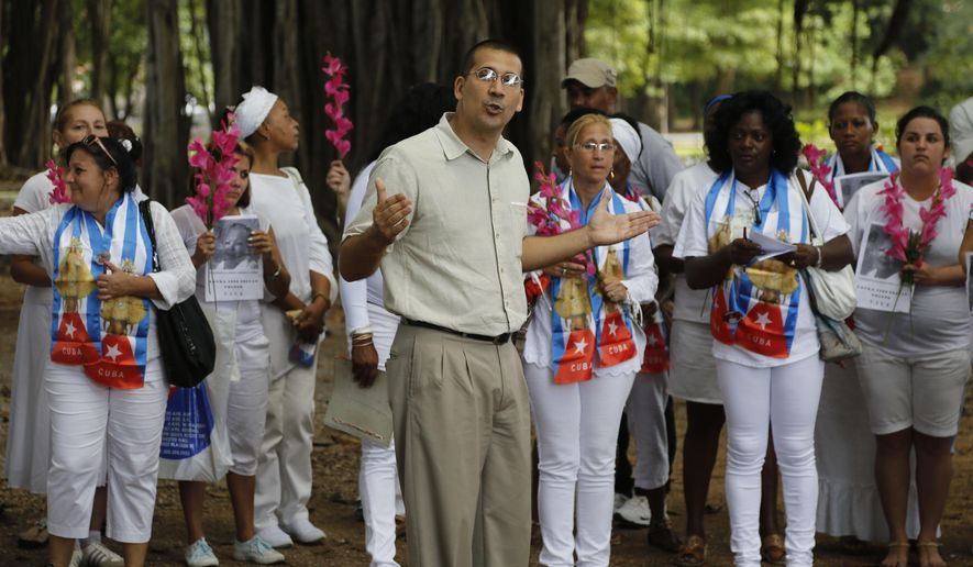 Antonio Rodiles, who has been speaking for years with the Ladies in White group and other Cuban dissidents, says the U.S. should continue to pressure the Castro government on human rights and other issues. (Associated Press/File)