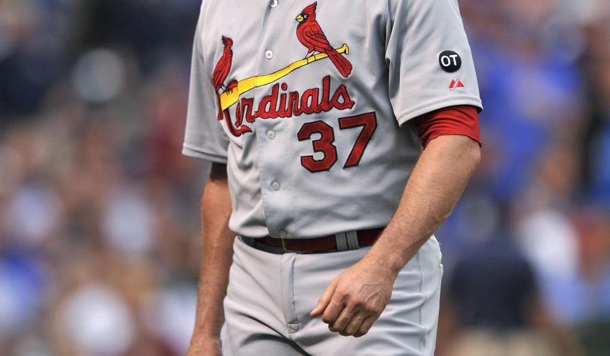 St. Louis Cardinals relief pitcher Matt Belisle reacts while being pulled after hitting Chicago Cubs' Anthony Rizzo with a pitch during the seventh inning of a baseball game Friday, Sept. 18, 2015 in Chicago. Chicago won 8-3. (AP Photo/Paul Beaty)