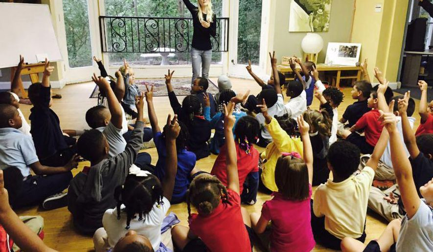Tiffany Tibbot teaches a lesson in peacemaking skills at Peace Learning Center, Sept. 11, 2015 in Indianapolis. On the 14th anniversary of the 9/11 terrorist attacks 100 first-, second- and third-graders from IPS School 56 came to the center to learn how to be peacemakers in their schools, their families and their communities. (Maureen Gilmer/The Indianapolis Star via AP)  NO SALES; MANDATORY CREDIT