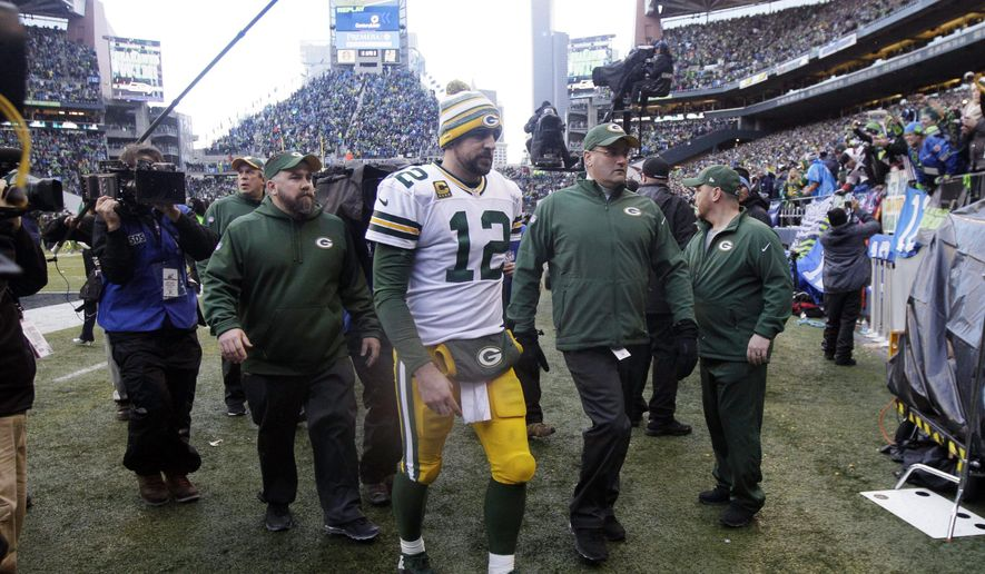 FILE - In this Jan. 18, 2015, file photo, Green Bay Packers quarterback Aaron Rodgers (12) walks off the field after losing  28-22 in the NFL football NFC Championship game against the Seattle Seahawks in Seattle. The Packers probably don't need any extra incentive when facing the Seahawks this Sunday, particularly with the memory of their fourth-quarter NFC championship collapse in Seattle still fresh and painful. (AP Photo/Jeff Chiu, File)