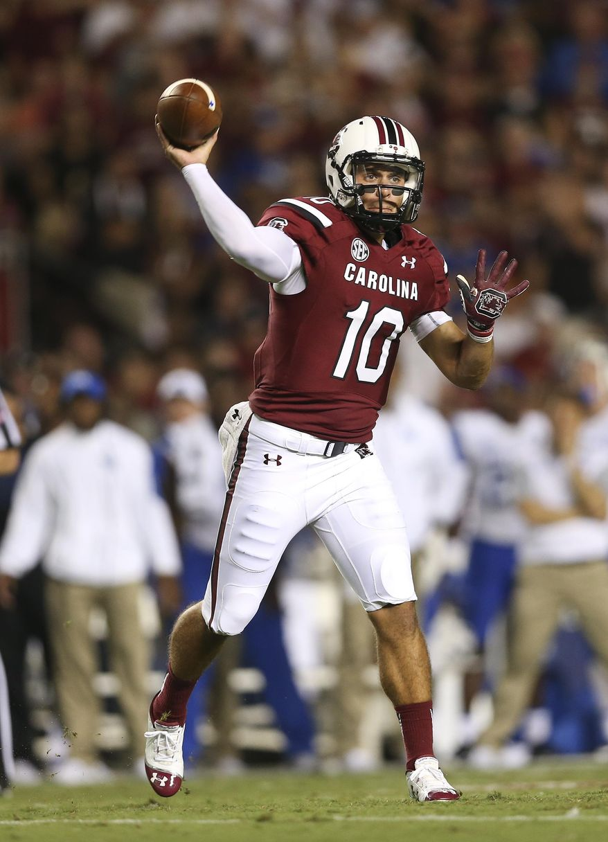 FILE- In this Saturday, Sept. 12, 2015, South Carolina quarterback Perry Orth (10) throws in the first half of an NCAA college football game against Kentucky in Columbia, S.C. Orth looks calm and unperturbed as he prepares for his first college start when South Carolina plays No. 7 Georgia this week. Then again, a few months back the former walk-on was stocking grocery shelves to help make some extra money for school. (AP Photo/John Bazemore, File)