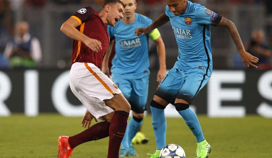 Barcelona's Neymar, right, takes on Roma's Edin Zdeko during a Champions League, Group E soccer match between Roma and Barcelona, at Rome's Olympic stadium Wednesday, Sept. 16, 2015. (AP Photo/Riccardo De Luca)