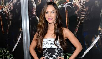 """In this Aug. 1, 2014 file photo, Megan Fox arrives at special screening of """"Teenage Mutant Ninja Turtles"""" at AMC Lincoln Square, in New York. (Photo by Evan Agostini/Invision/AP, File)"""