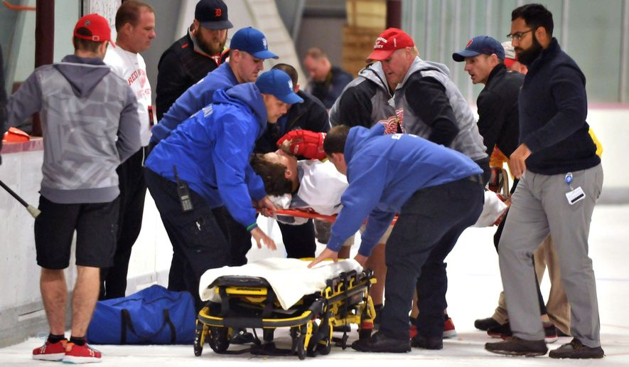 Detroit Red Wings forward Jerome Verrier is loaded onto a gurney after a collison on the ice with teammate Darren Helm during NHL hockey training camp, Friday, Sept 18, 2015, in Traverse City, Mich. (AP Photo/ John L. Russell)