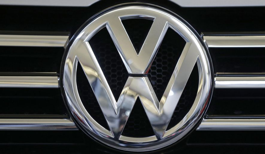 In this photo taken Feb. 14, 2013, a Volkswagen logo is seen on the grill of a Volkswagen on display in Pittsburgh. The Environmental Protection Agency (EPA)  says nearly 500,000 Volkswagen and Audi diesel cars built in the past seven year are intentionally violating clean air standards by using software that evades EPA emissions standards. (AP Photo/Gene J. Puskar)