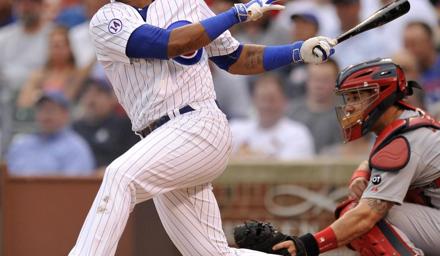 Chicago Cubs' Starlin Castro watches his RBI single during the first inning of a baseball game against the St. Louis Cardinals, Friday, Sept. 18, 2015, in Chicago. (AP Photo/Paul Beaty)