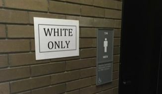 "A black University of Buffalo graduate student has admitted to posting ""White Only"" and ""Black Only"" signs near several bathrooms and water fountains as part of a class project. (WVIB-TV)"