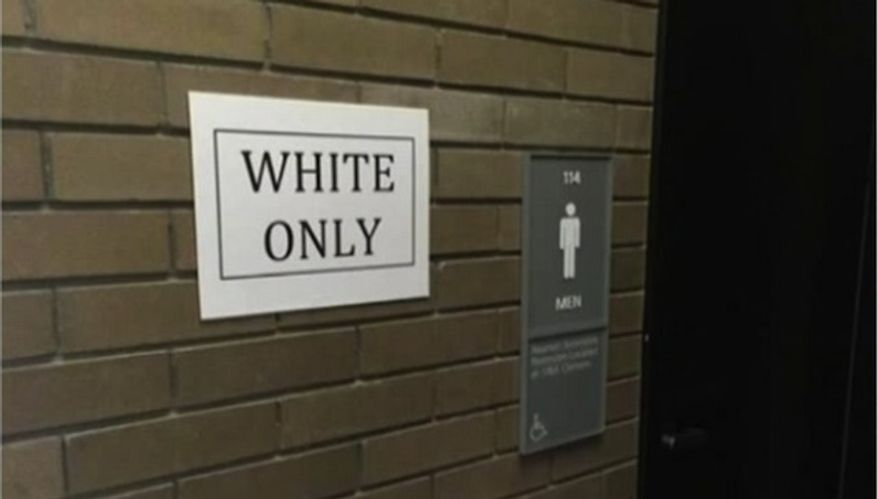 """A black University of Buffalo graduate student has admitted to posting """"White Only"""" and """"Black Only"""" signs near several bathrooms and water fountains as part of a class project. (WVIB-TV)"""