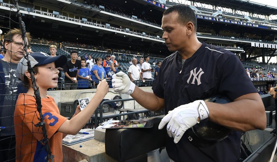New York Yankees' Alex Rodriguez pumps fists with Alex Weissman, 11, of Livingston, N.J. after signing an autograph for him during batting practice before the  interleague baseball game between the Yankees and the New York Mets at Citi Field, Friday, Sept. 18, 2015, in New York. (AP Photo/Kathy Kmonicek)