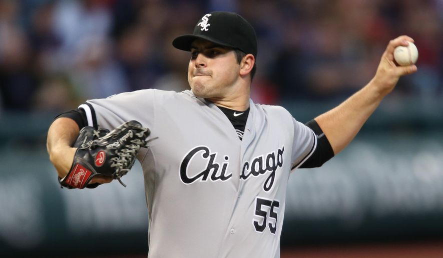 Chicago White Sox starting pitcher Carlos Rodon delivers to a Cleveland Indians batter during the first inning of a baseball game, Saturday, Sept. 19, 2015, in Cleveland. (AP Photo/Ron Schwane)
