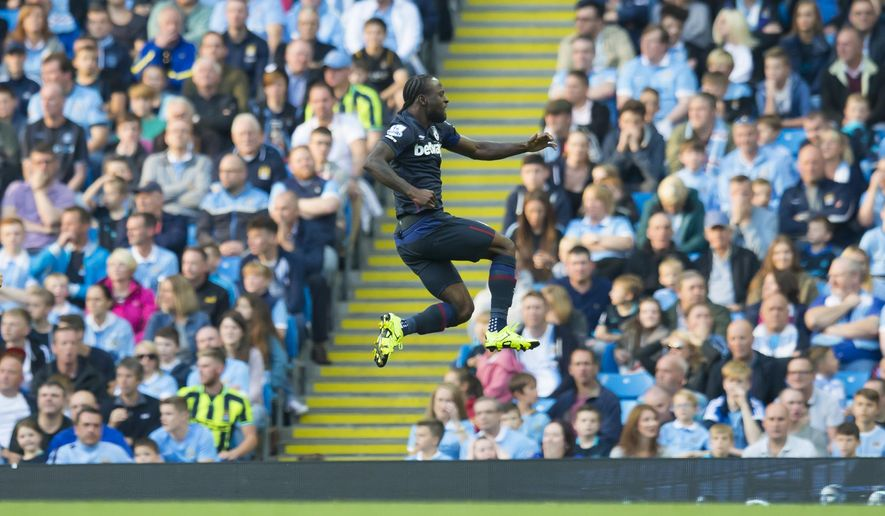 West Ham United's Victor Moses celebrates after scoring during the English Premier League soccer match between Manchester City and West Ham United at the Etihad Stadium, Manchester, England, Saturday Sept. 19, 2015. (AP Photo/Jon Super)