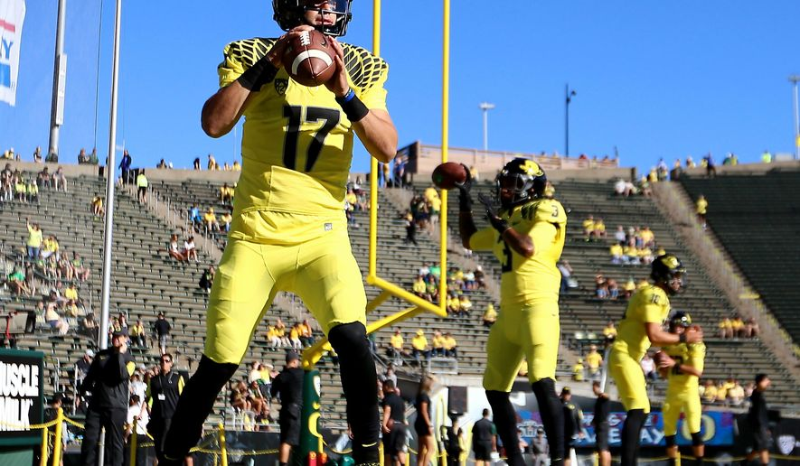 Oregon quarterback Jeff Lockie (17) warms up before the start of an NCAA college football game against Georgia State, Saturday, Sept. 19, 2015, in Eugene, Ore. (AP Photo/Ryan Kang)
