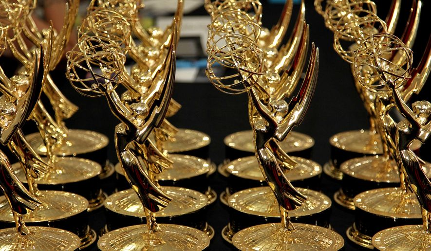 FILE - In this Sept. 23, 2012 file photo, statues of the 64th Emmy awards are displayed on a table backstage at the 64th Primetime Emmy Awards at the Nokia Theatre in Los Angeles. The 67th annual Primetime Emmy Awards airs Sunday, Sept. 20, 2015, at 8 ET/5 PT on FOX.  (Photo by Matt Sayles/Invision/AP, File)
