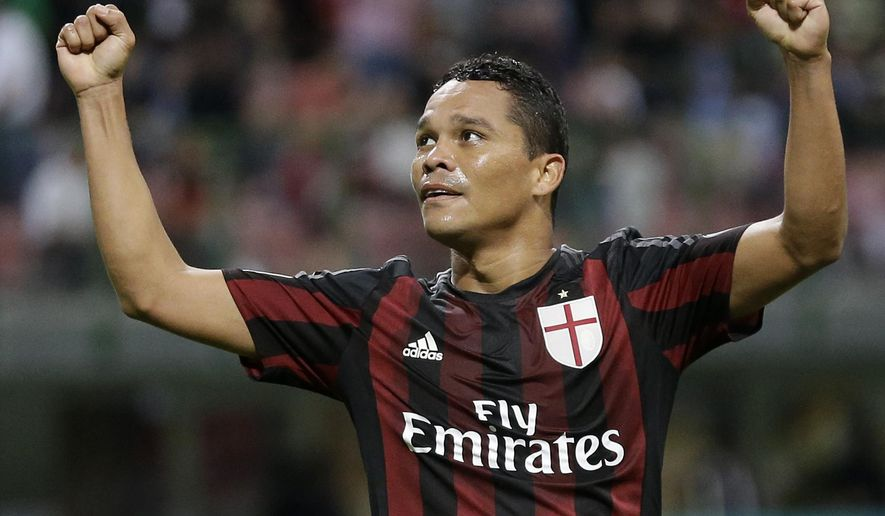 AC Milan's Carlos Bacca celebrates after scoring during the Serie A soccer match between AC Milan and Palermo at the San Siro stadium in Milan, Italy, Saturday, Sept. 19, 2015. (AP Photo/Antonio Calanni)