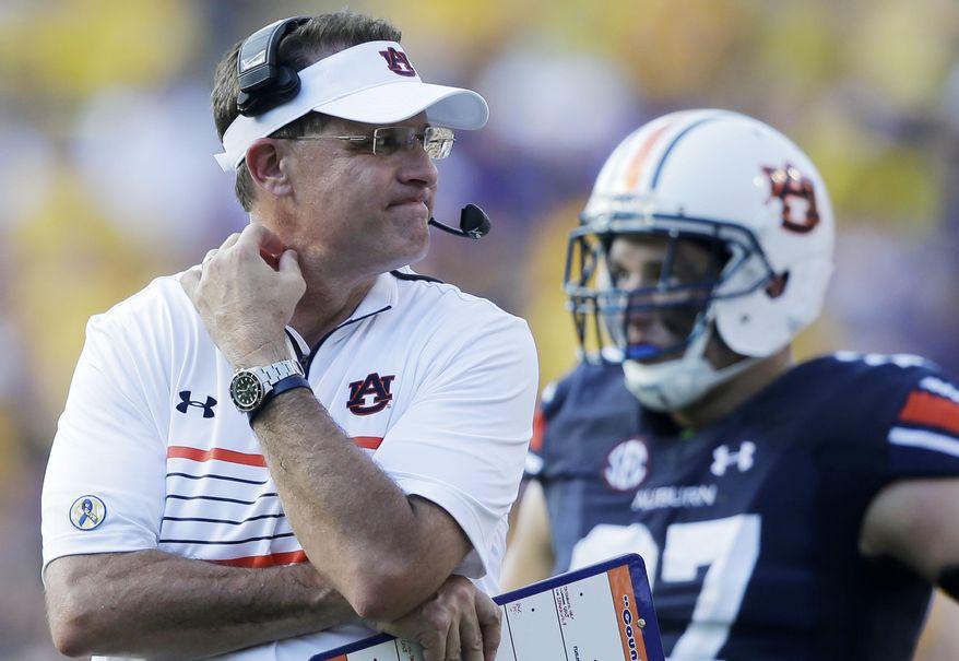 Auburn head coach Gus Malzahn reacts in the second half of an NCAA college football game against LSU in Baton Rouge, La., Saturday, Sept. 19, 2015. LSU won 45-21. (AP Photo/Gerald Herbert)