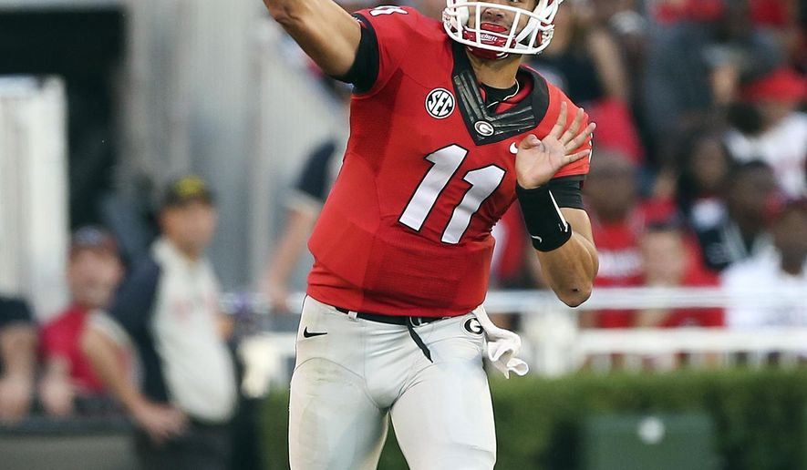 Georgia quarterback Greyson Lambert (11) throws a pass during the first half of an NCAA college football game against the South Carolina on Saturday, Sept. 19, 2015, in Athens, Ga. (AP Photo/John Bazemore)