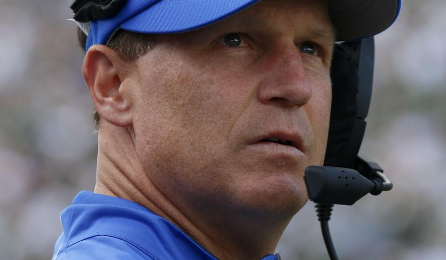 Air Force coach Troy Calhoun looks out from the sideline during the fourth quarter of an NCAA college football game against Michigan State, Saturday, Sept. 19, 2015, in East Lansing, Mich. Michigan State won 35-21. (AP Photo/Al Goldis)