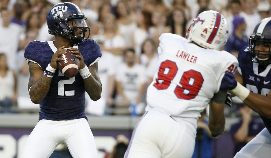 TCU quarterback Trevone Boykin (2) prepares to throw under pressure from SMU's Justin Lawler (99) during the first half of an NCAA college football game Saturday, Sept. 19, 2015, in Fort Worth, Texas. (AP Photo/Tony Gutierrez)