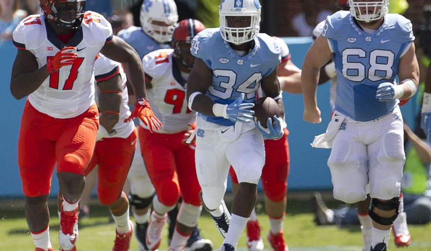 North Carolina tailback Elijah Hood (34) breaks into the open field for a 39 yard gain in the first half of an NCAA football game against Illinois on Saturday, Sept. 19, 2015 at Kenan Stadium in Chapel Hill, N.C. (Robert Willett/The News & Observer via AP)
