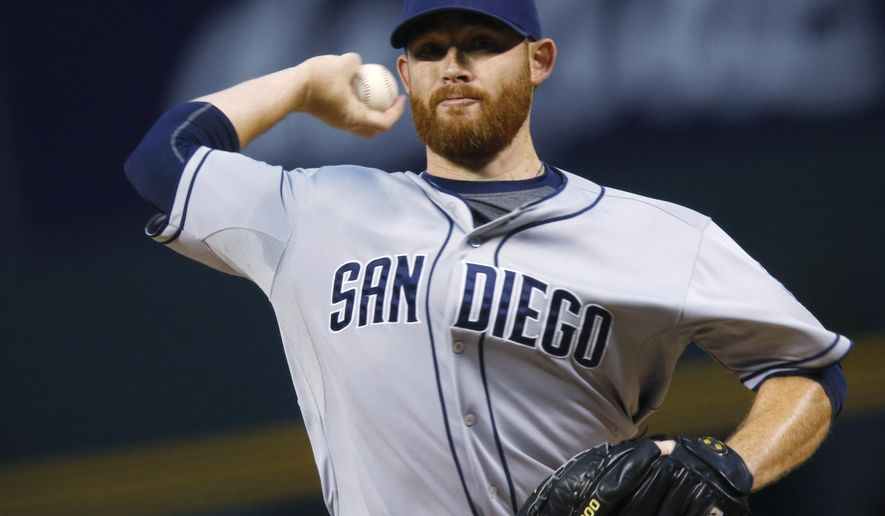 San Diego Padres starting pitcher Ian Kennedy works against the Colorado Rockies diuring the first inning of a baseball game Friday, Sept. 18, 2015, in Denver. (AP Photo/David Zalubowski)