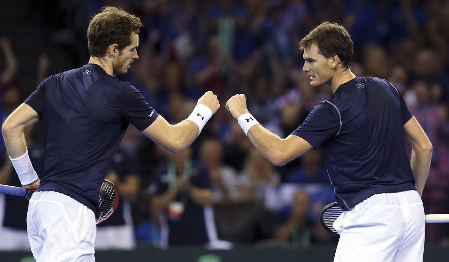 Britain's Andy Murray, left, and Jamie Murray, right, celebrate winning a point from Australia's Sam Groth and Lleyton Hewitt during the semifinal doubles tennis match between Britain and Australia of the Davis Cup in Glasgow, Saturday Sept. 19, 2015. (AP Photo/Scott Heppell)